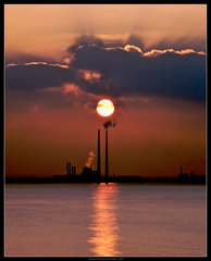Poolbeg sunset by Philip Milne - Poolbeg chimneys. A monument to the sunset industries of the fossil fuel age. Photo by Philip Milne.